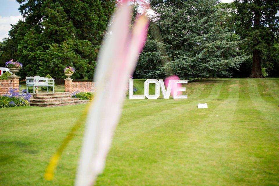 Garden Barn Suffolk wedding photography_tatum reid_blush pink bride_pastel dresses, multicolour, diy wedding decor_succulents_paper flowers_garden games_newmarket (54)