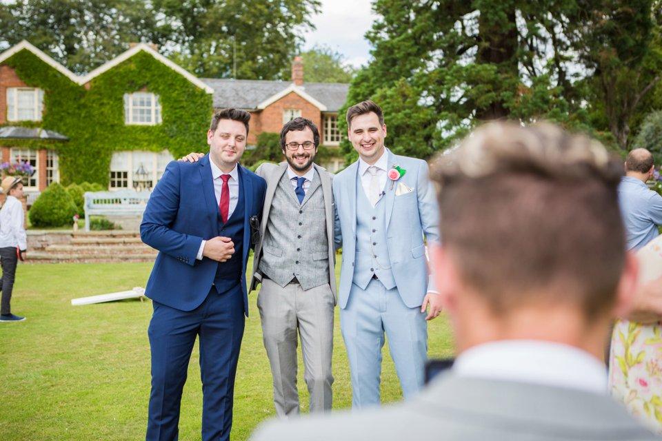 Garden Barn Suffolk wedding photography_tatum reid_blush pink bride_pastel dresses, multicolour, diy wedding decor_succulents_paper flowers_garden games_newmarket (41)