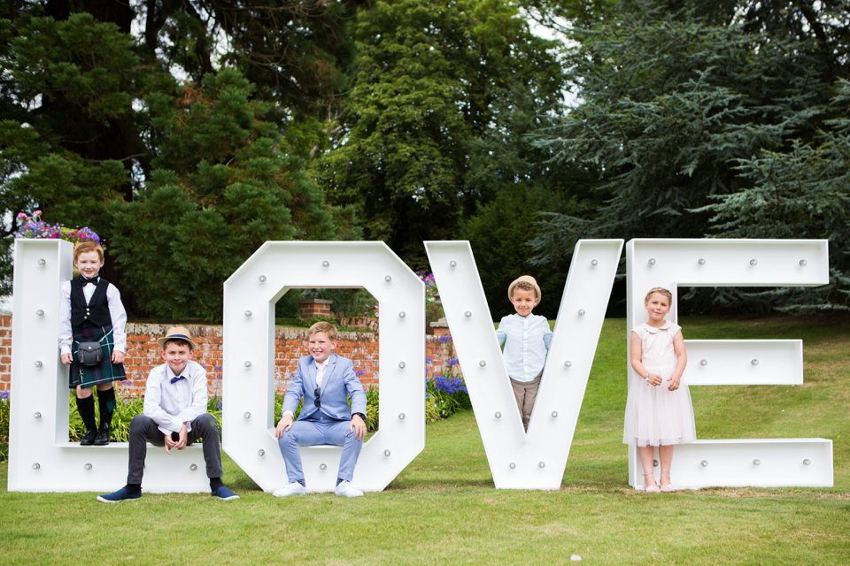 Garden Barn Suffolk wedding photography_tatum reid_blush pink bride_pastel dresses, multicolour, diy wedding decor_succulents_paper flowers_garden games_newmarket (38)
