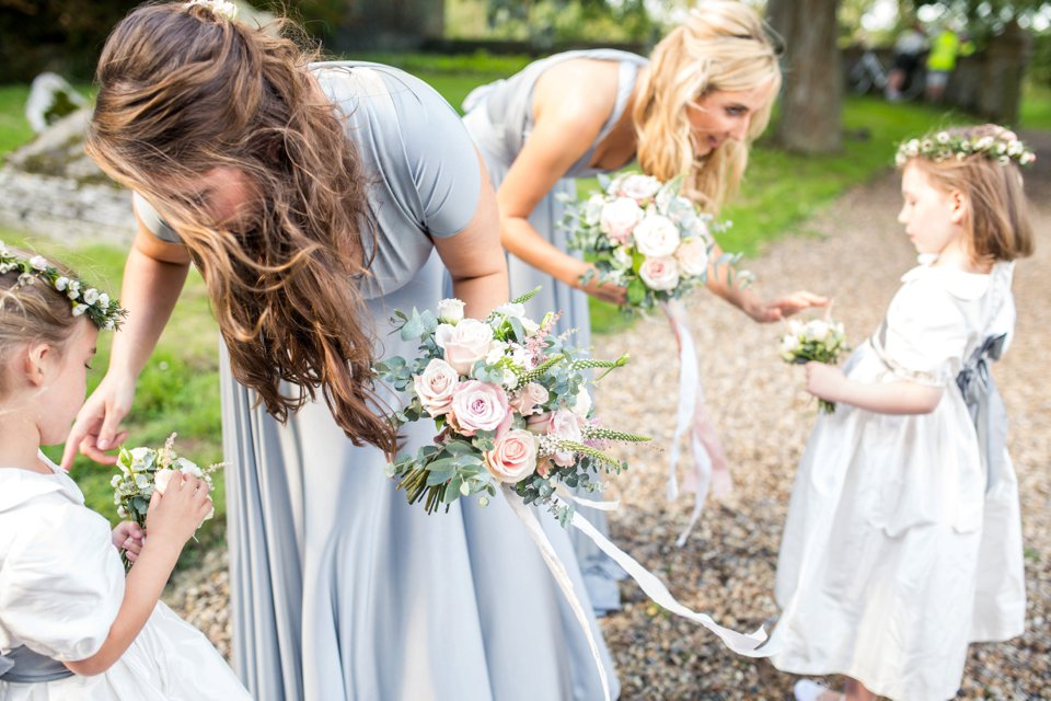 Soft grey and blue tones_bridesmaids dresses_suzanne neville gown_north norfolk wedding photographer_white calligraphy_tatum reid_celia and tom (36)