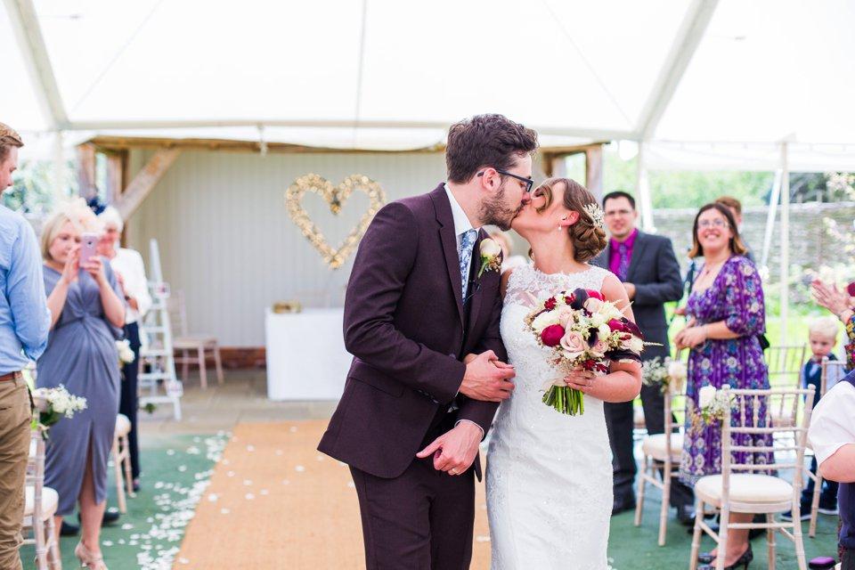 Outdoor marquee wedding in summer_houchins wedding venue_essex_wedding photography_modern barn rustic venue_norfolk wedding photographer_suffolk wedding photographer (46)