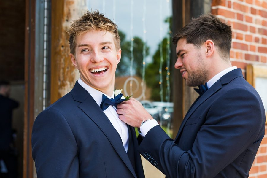 Southwood Hall wedding, bowties being put on by groom