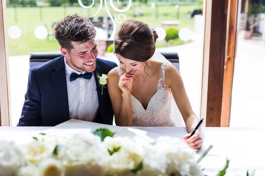 Southwood Hall wedding bride and groom signing registry