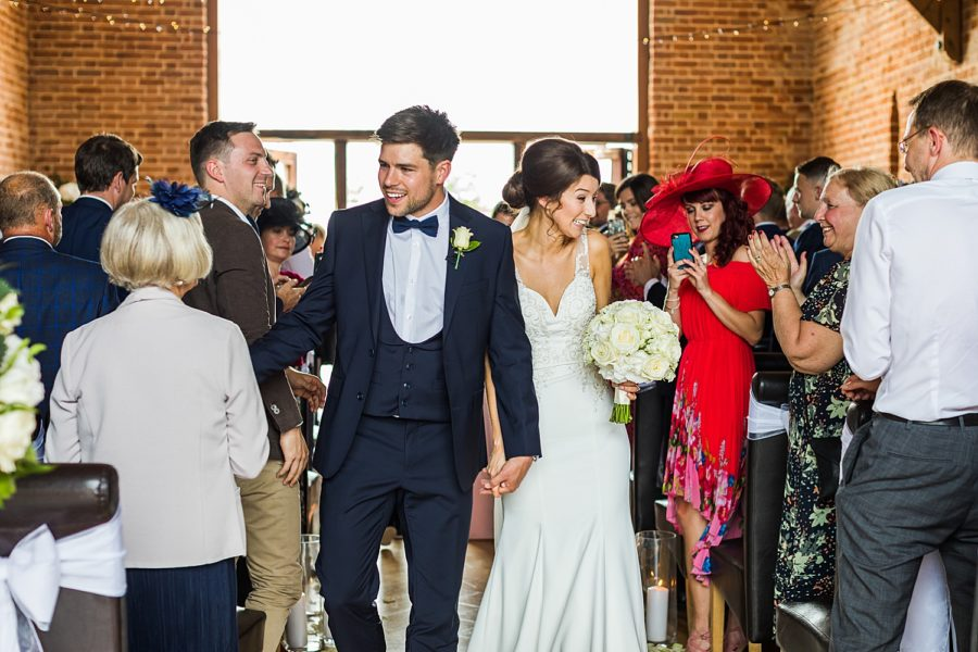 Southwood Hall wedding bride and groom walking down isle