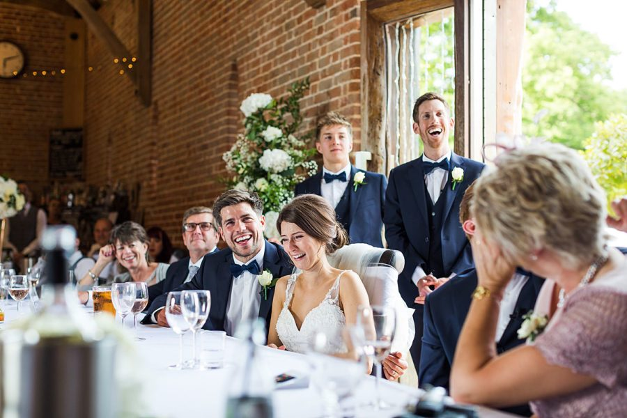 Southwood Hall wedding bride and groom laughing at speeches