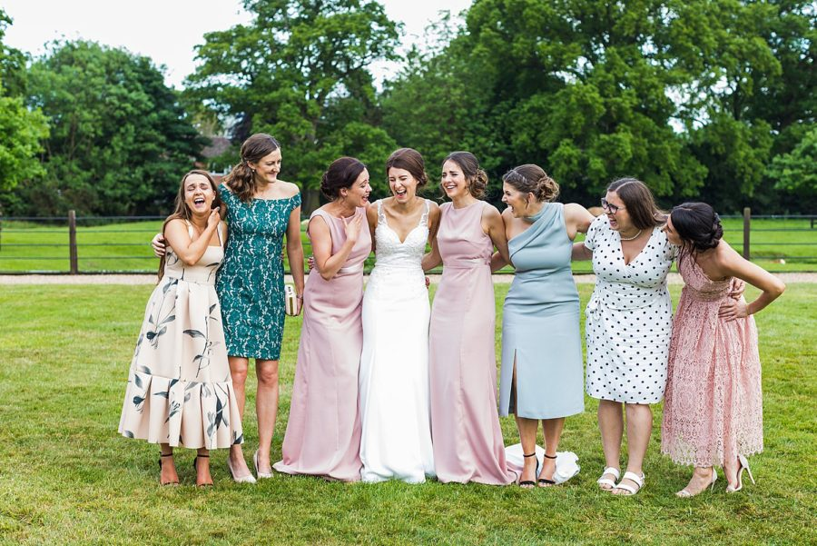 Southwood Hall wedding candid photo of bride with girlfriends laughing