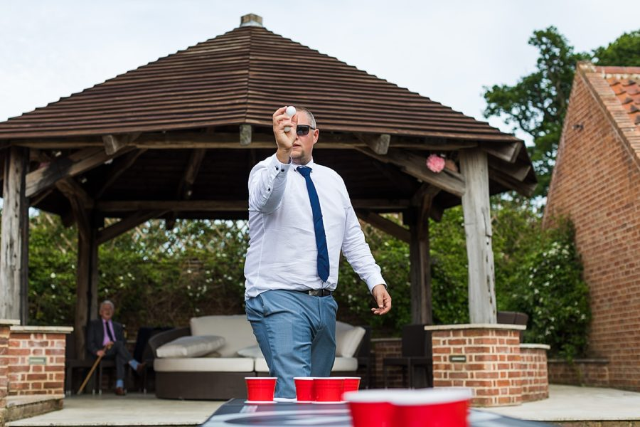 Southwood Hall wedding guest playing beer ping pong