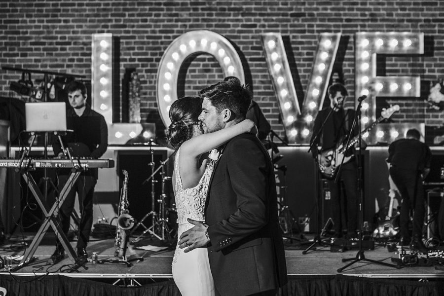 Southwood Hall wedding with bride and groom dancing in front of LOVE light up letters